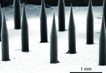 Biocompatible near-infrared quantum dots delivered to the skin by microneedle patches record vaccination